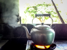 Old iron kettle on the fire